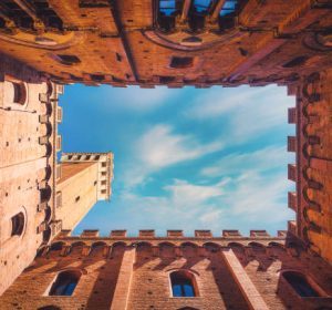 Wide angle view of famous Torre del Mangia at Palazzo Pubblico in Siena, Italy