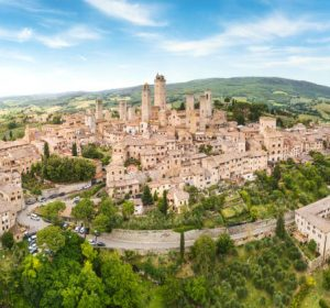 San Gimignano from above, panoramic aerial view from town to country. Tuscany, Italy