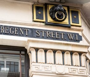 A traditional sign for Regent Street, one of central London's most popular shopping streets.