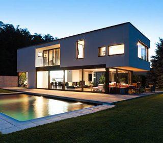 Modern villa with pool, night scene