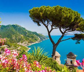 Scenic picture-postcard view of famous Amalfi Coast with Gulf of Salerno from Villa Rufolo gardens in Ravello, Campania, Italy.