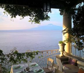 Terrace view from the dining table of the gulf/bay of Naples with mount Vesuvius in the background.