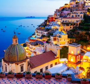 Positano, Amalfi Coast, Campania, Sorrento, Italy. View of the town and the seaside in a summer sunset